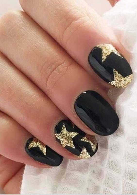 Black Polish with Gold Stars Nail Arts